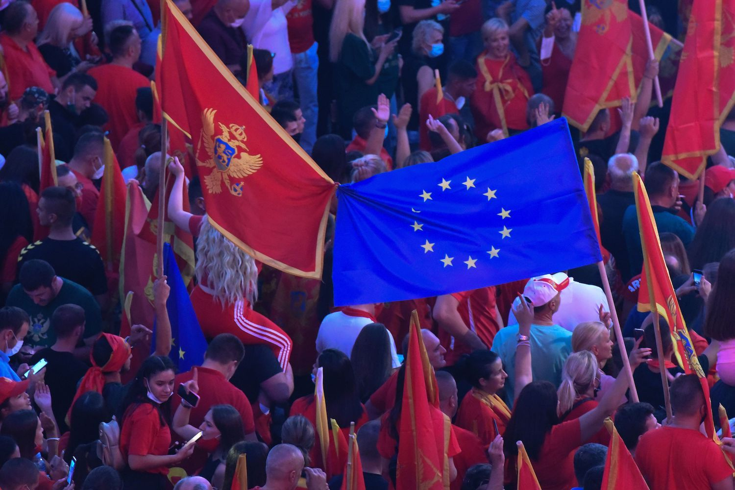 Self-described patriots wave national flags and European flag during a post-election rally in Podgorica, on September 6, 2020. - Supporters of President Milo Djukanovic and his Democratic Party of Socialists (DPS) have staged a rally in support of Montenegro's sovereignty, as local media report. (Photo by Savo PRELEVIC / AFP) (Photo by SAVO PRELEVIC/AFP via Getty Images)